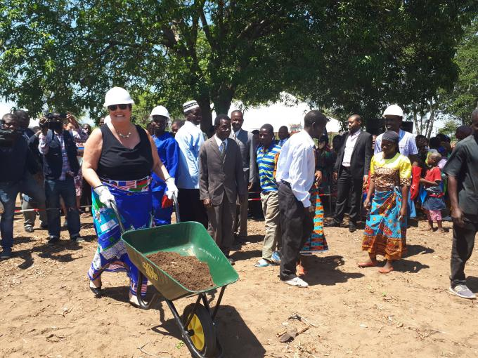 Ambassador Palmer breaks the ground to commence construction work for the school